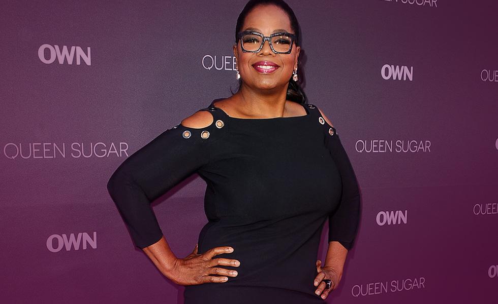Oprah Winfrey showcases svelte figure,